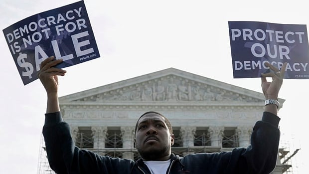 Cornell Woolridge of Windsor Mill, Md., takes part in a demonstration outside the Supreme Court last fall when it was holding hearings on campaign contributions.