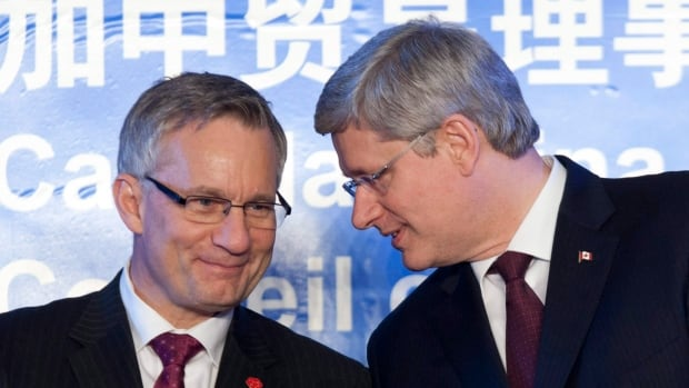 International Trade Minister Ed Fast, left, announced today he will be leading a six-day trade mission to China in May. He is seen here speaking with Prime Minister Stephen Harper during a ceremony in Beijing on Feb. 9, 2012.