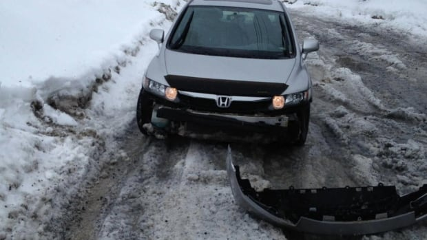 Residents in Corner Brook's only trailer court say the back road they have to drive on is filled with potholes and ruts.