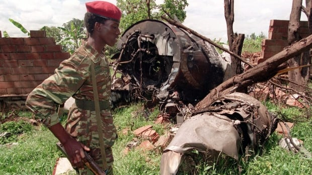 A Rwanda Patriotic Front (RPF) rebel walks by the site of the April 6, 1994, plane crash that killed President Juvenal Habyarimana, triggering the genocide.