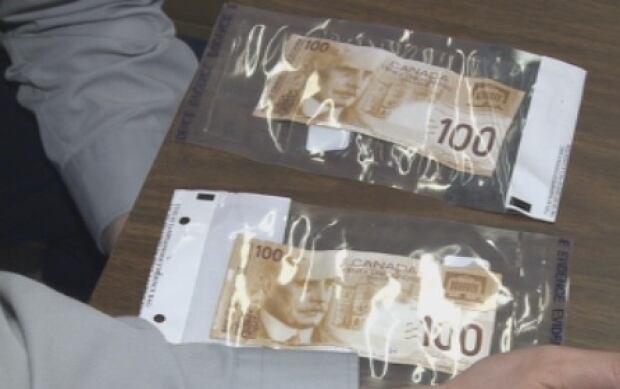 Counterfeit bills - Daley 2014