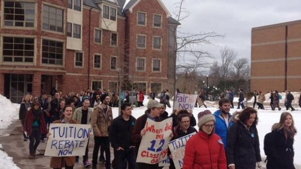 Over 100 students protested against Mount Allison University's president and administration Friday, after learning they would not get tuition rebates for three weeks of lost classes.