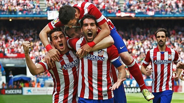 Atletico's Raul Garcia, center right, celebrates his goal with teammates during a Spanish La Liga soccer match between Atletico Madrid and Villarreal in Madrid, Spain, on Saturday.