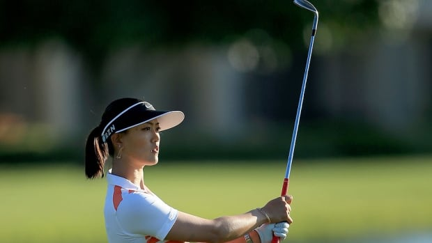 Michelle Wie plays her third shot at the par 5, 18th hole during the third round of the Kraft Nabisco championship on Saturday. She carded a 68 to set up a final-round showdown with Lexi Thompson.