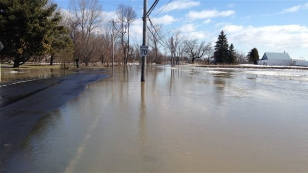 Parts of Salaberry Road in Carignan has been flooded by water overflowing the banks of the Acadia River