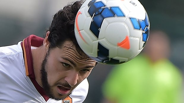 AS Roma's forward Mattia Destro heads the ball during a match against Cagliari on Sunday.