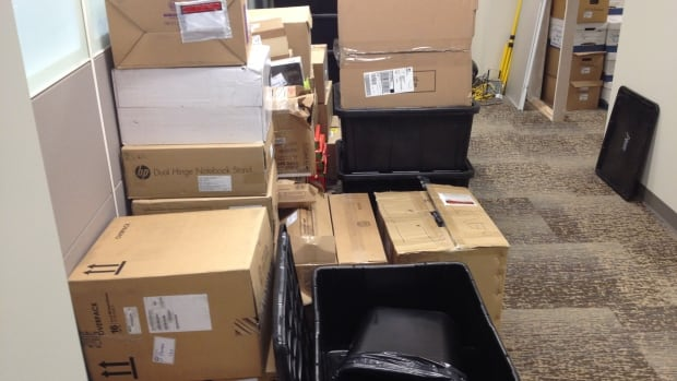 Boxes stacked in the High River town office as employees prepare to move back in following flood repairs.