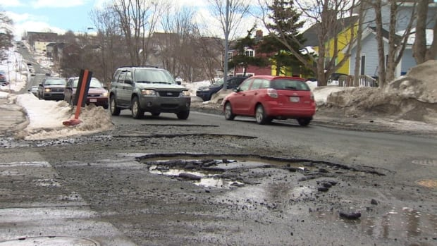 These monstrous potholes on Bonaventure Ave. in St. John's were slowing down traffic on Monday. Later that day, crews from the city were dispatched to make a temporary patch to the holes.