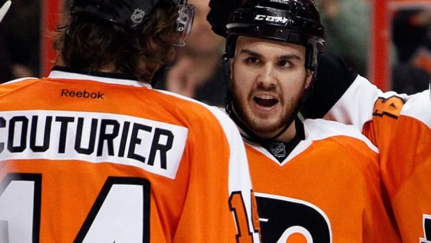 The Flyers' Zac Rinaldo, right, will sit four games after incurring a match penalty for a hit to the head of Buffalo defenceman Chad Ruhwedel on Sunday.