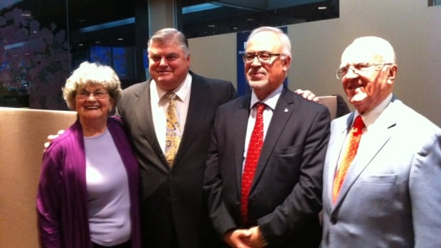 Liberal candidate Carlos Leitao (centre right) is with supporters and former Liberal MNA Pierre Marsan  (centre left) in the riding of Robert-Baldwin.