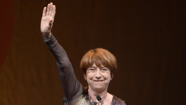 Quebec Solidaire co-leader Francoise David waves after her victory speech in Montreal on Monday.