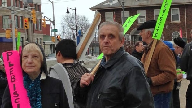 Thunder Bay residents in support of a plebiscite held a rally in front of city hall, before council met on Monday night.