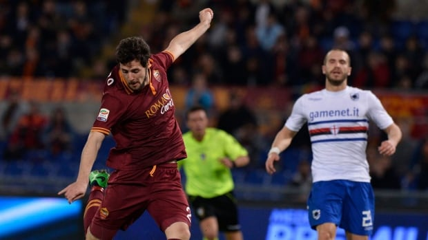 AS Roma's Mattia Destro, left, is shown during a match in February.