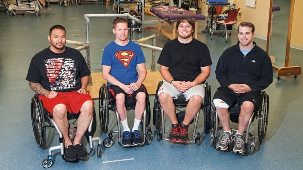 In this undated photo provided by the University of Louisville, from left to right, are Andrew Meas, Dustin Shillcox, Kent Stephenson and Rob Summers, the first four to undergo a spinal stimulation treatment at the University of Louisville's Kentucky Spinal Cord Injury Research Centre.