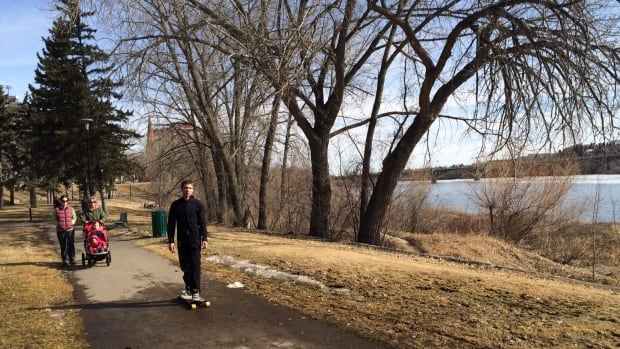 People enjoy the path along the South Saskatchewan River on a sunny spring afternoon.