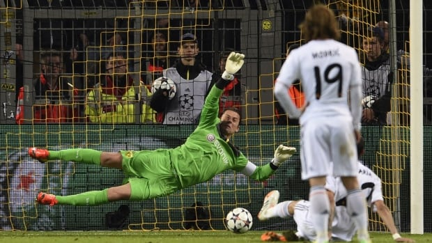 Dortmund's goalkeeper Roman Weidenfeller, left, saves a penalty shot by Real Madrid's Argentinian midfielder Angel di Maria during the UEFA Champions League quarter-final, second leg football match on Tuesday.