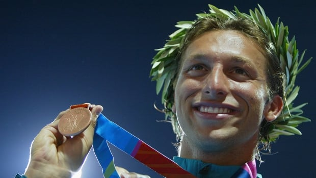 Ian Thorpe of Australia is seen here celebrating his bronze medal on the podium during the men's swimming 100-metre freestyle event on August 18, 2004 during the Athens Summer Olympic Games. Thorpe, who is one of the most decorated Olympic swimmers ever, has contracted two potentially-deadly infections while undergoing shoulder surgery and will never swim again.
