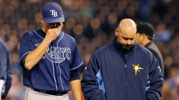 Tampa Bay Rays starting pitcher Matt Moore, left, walks off the field with a trainer following an injury during the sixth inning a game against the Kansas City Royals at Kauffman Stadium on Monday. On Tuesday, Moore was placed on the disabled list.