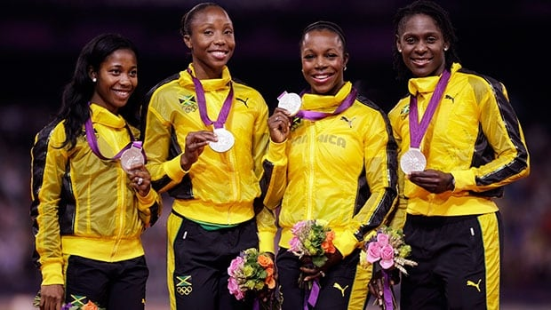 From left to right, Jamaica's Shelly-Ann Fraser-Pryce, Sherone Simpson, Veronica Campbell-Brown and Kerron Stewart earned a silver medal in women's 4x100-metre race at the 2012 London Olympics.