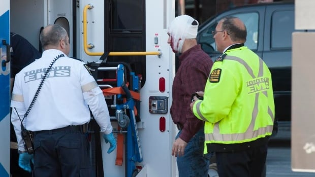 An injured man is seen after a stabbing at an office building near Yonge Street and York Mills Road on Wednesday morning.