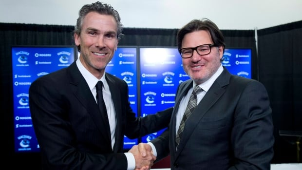 Trevor Linden, left, and Vancouver Canucks owner Francesco Aquilini pose for a photo following a press conference in Vancouver on Wednesday. Former Canucks captain Trevor Linden has been named the team's president of hockey operations.