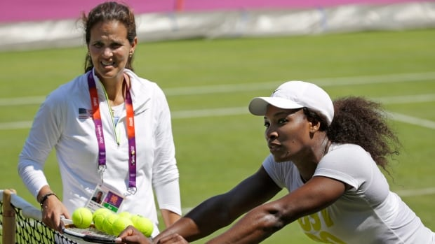 Serena Williams, right, of the United States leans on the net post during training with coach Mary Joe Fernandez last year. Fernandez announced Wednesday that Williams will not be participating in the upcoming Fed Cup for the United States.