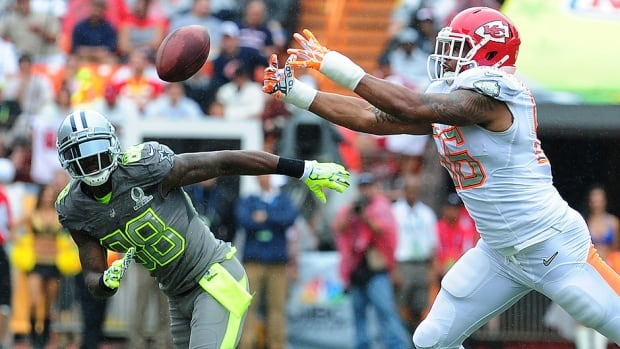 The Chiefs' Derrick Johnson, right, is seen defending a pass against the Cowboys' Dez Bryant during the 2014 Pro Bowl at Aloha Stadium in Hawaii. Next season, the NFL all-star game will be contested in Arizona before returning to Hawaii in 2016.