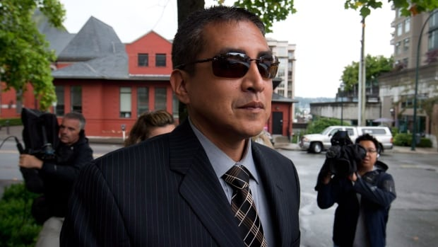 Former RCMP Cpl. Benjamin (Monty) Robinson leaves B.C. Supreme Court in New Westminster, B.C., on Friday July 20, 2012. Robinson was one of four officers involved in the Robert Dziekanski case.