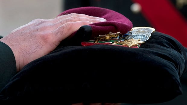 Warrant Office Michael Robert McNeil's beret and medals are carried at his funeral at the Truro Armouries in Truro, N.S. on Thursday, Dec. 5, 2013. McNeil completed several tours of duty including Afghanistan, Bosnia and Croatia. McNeil took his own life in November at CFB Petawawa.