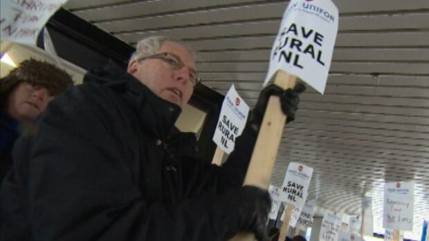 Placard-waving protesters started a demonstration on Wednesday at DFO's offices in Corner Brook.