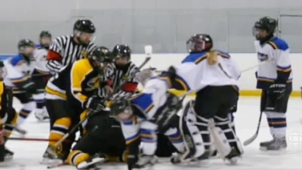 Referees try to control the fights at a march 30 game between the Stonewall Blues and Lake Manitoba First Nation.