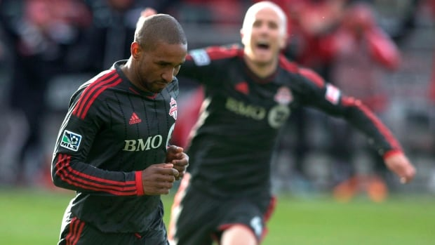 Toronto FC 's Jermain Defoe, left, celebrates a goal on March 22, with Michael Bradley  seen in the background.