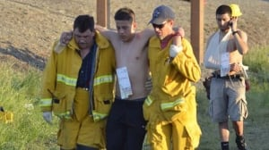 Rescuers tend to walking wounded after a fiery crash on Thursday involving several vehicles just north of Orland, Calif., left at least nine dead.