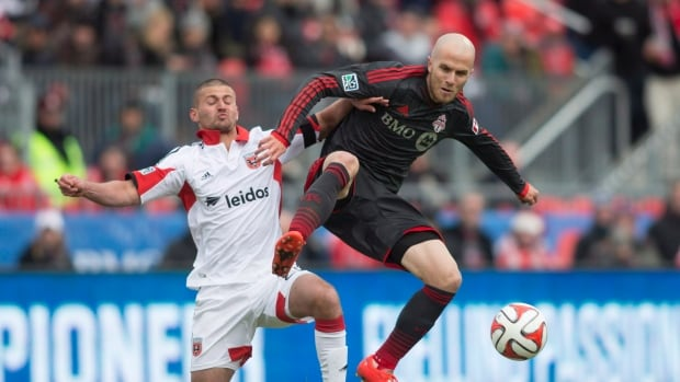 Toronto FC 's Michael Bradley (right) is seen battling for the ball in a March 22 contest.