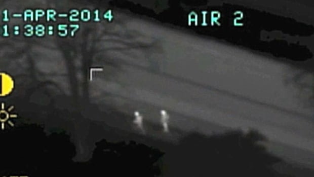 Two suspected car thieves run from police unaware of how well they're showing up on Air One's thermal imaging camera.