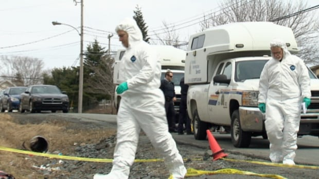 Investigators in forensic suits searched for evidence at the residence on Clarence Street.