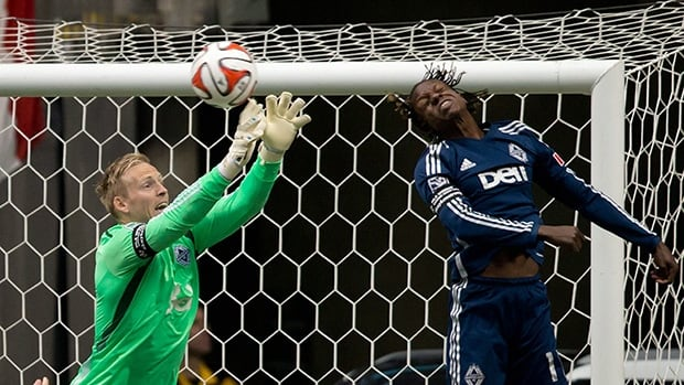 Vancouver Whitecaps' goalkeeper David Ousted, left, and teammate Darren Mattocks,will try and help their team get their first win in Los Angeles on Saturday.