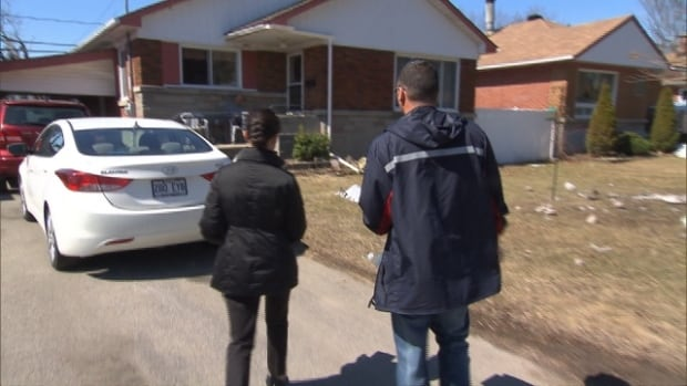NDP MP Laurin Liu and a volunteer go door-to-door in St-Eustache on Saturday to rally the community against cuts to home mail delivery.