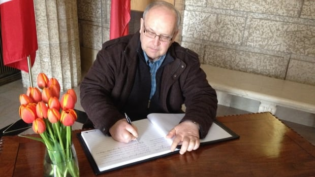 Brad Watson signed the book of condolences to express his appreciation for Flaherty's years of service to Canadians.
