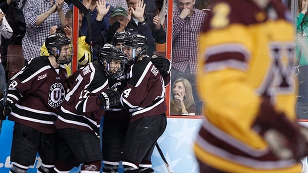 Union's Daniel Ciampini, center left, reacts to his goal with teammates as Minnesota's Brady Skjei skates by during the first period of the NCAA men's college hockey final on Saturday in Philadelphia.