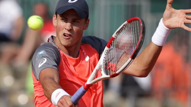 Canada's Vasek Pospisil returns the ball to Spain's Roberto Bautista Agut in their first-round match at the Monte Carlo Masters in Monaco on Monday. Pospisil dropped a 6-2, 6-2 decision.