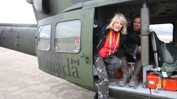 Susan R. Eaton emerges from a Royal Canadian Air Force CH-146 Griffon tactical helicopter at Arctic Bay. Eaton was among a group of tourists rescued from the sea ice on North Baffin Island last summer, when the ice they were camping on unexpectedly broke apart and began to drift away.