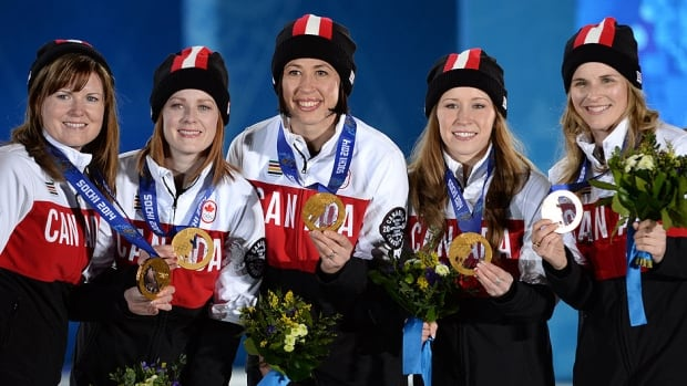 Canadian gold medallists Kirsten Wall (alternate), lead Dawn McEwen, second Jill Officer, third Kaitlyn Lawes and skip Jennifer Jones celebrate their Olympic victory in Sochi, Russia on Feb. 22. Jones announced that McEwen, Officer and Lawes would return in hopes of defending gold in South Korea in 2018. Coach Janet Arnott is leaving the team.
