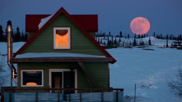 'Here is my favourite image from last evening's shoot down on Yellowknife Bay,' wrote Yellowknife photographer Arthur Boutilier on Facebook. He shot this photo around 9 p.m., just as the blood moon was rising.