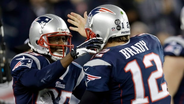 Brandon Lloyd, left, gets congratulated by New England quarterback Tom Brady after a touchdown reception in a Jan. 13 playoff game.