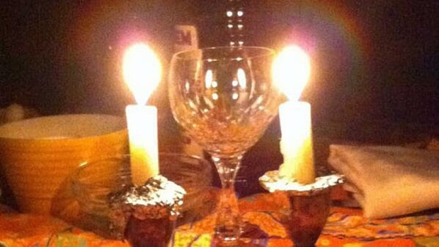 This photo shows a seder table illuminated only by candlelight during Toronto's power outage last night.