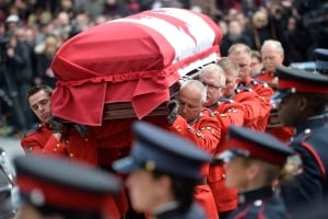 RCMP carry Flaherty casket Flaherty Funeral Apr 16 2014