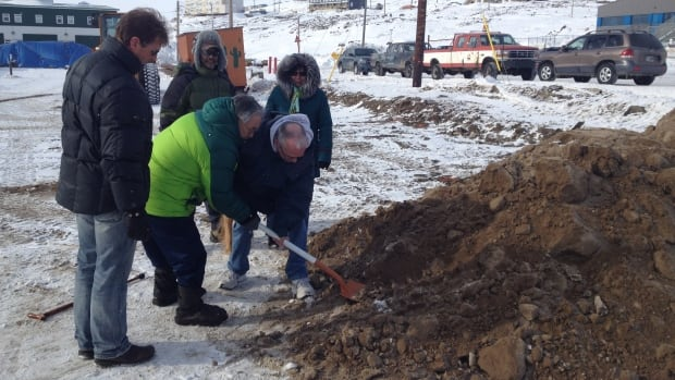 Iqaluit Mayor John Graham and city councillors break ground on the new pool on Wednesday afternoon.