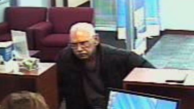This Feb. 9, 2013, surveillance photo from the FBI shows Walter Unbehaun, then 73, during a bank robbery in Niles, Ill. Unbehaun allegedly told investigators he intended to get caught so he could go back to prison.