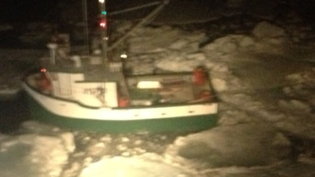 Four crew members were forced to abandon their ice-bound vessel on Wednesday night.